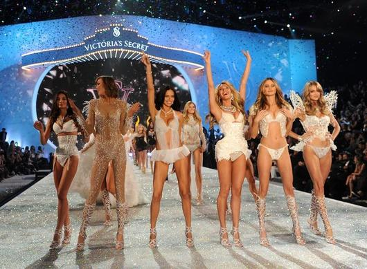 From left, models Lily Aldridge, Karlie Kloss, Adriana Lima, Candice Swanepoel, Behati Prinsloo and Lindsay Ellingson walk the runway Wednesday at the 2013 Victoria's Secret Fashion Show at Lexington Avenue Armory in New York.