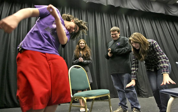 File Photo: Former Hoover drama students act out during a 24-Hour Improv marathon at the school in January 2009. From the left are Miles Mathews, Sarah Safuto , Justin Potter and Jeremie Peters.