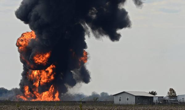 A large ball of fire burns in an open field after a gas line exploded outside of Milford, Texas.