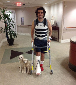 Dario Franchitti poses with his dogs, Shug and Buttermilk, in a photo taken by his brother, Marino Franchitti, at Memorial Hermann-Texas Medical Center in Houston on Oct. 10.