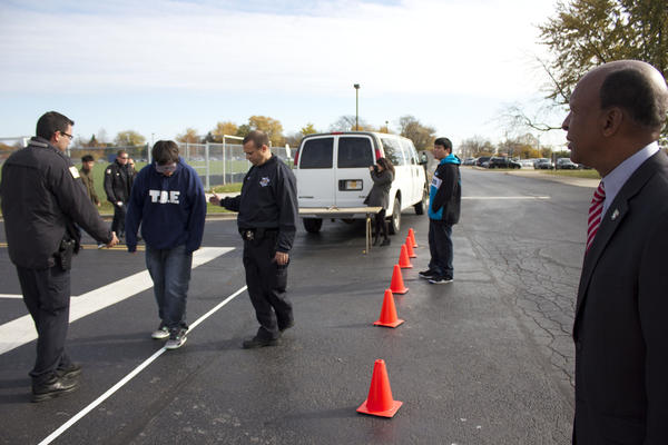 Glenbrook South High School students try out beer goggles as part of the school's drivers education program's demonstration on Thursday, Nov. 7.