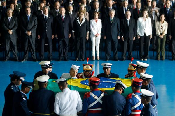Brazilian President Dilma Rousseff, sixth from the right, stands next to Maria Teresa Goulart, widow of former President Joo Goulart, and other dignitaries at a reception during the arrival of Goulart's coffin at the air base in Brasilia.