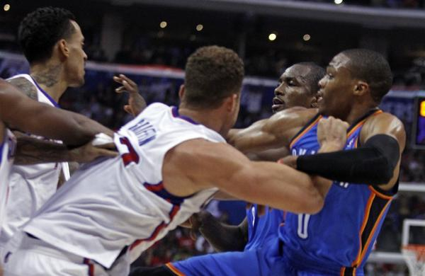 Matt Barnes, left and Blake Griffin, second from left, tangle with Oklahoma City Thunder forward Serge Ibaka, second from right and Thunder guard Russell Westbrook