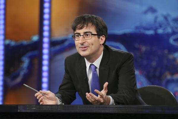 "John Oliver as summer guest host of ""The Daily Show with Jon Stewart"" on June 10, 2013 in New York City."