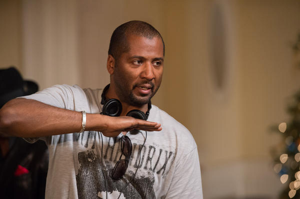 "Writer/Director Malcolm D. Lee on the set of ""The Best Man Holiday."""