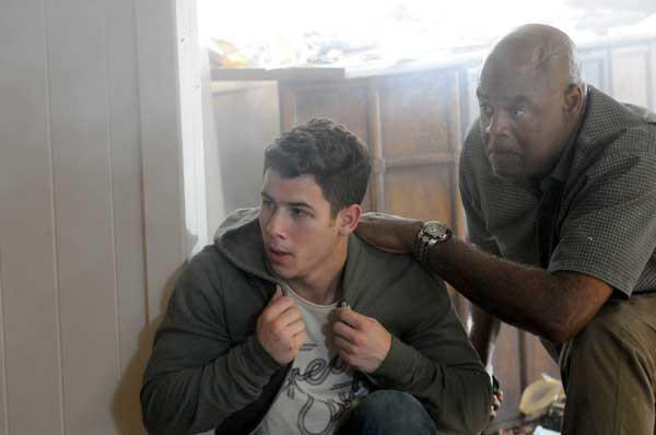 """A young hacker (Nick Jonas, left) is targeted on """"Hawaii Five-0."""" With Chi McBride."""