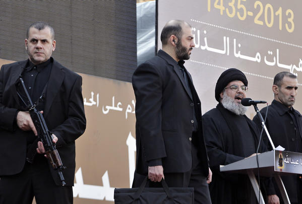 Hezbollah leader Hassan Nasrallah speaks to the crowd in a rare public appearance Thursday in Beirut.