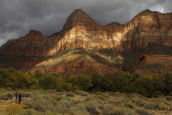 The late afternoon sun in October lights up the entrance to Zion National Park in Utah. Thousands of hikers, bikers and nature-lovers traveled to Utah's red rock national parks after the state paid to reopen them during the government shutdown.