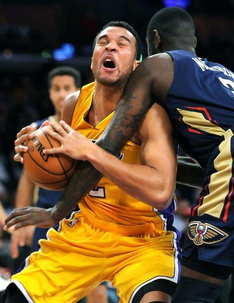 The Lakers' Elias Harris is fouled by the Pelicans' Anthony Morrow while driving to the basket during the Lakers' 116-95 victory over New Orleans on Tuesday at Staples Center.