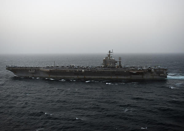 The aircraft carrier USS Abraham Lincoln patrols the Persian Gulf. Federal prosecutors believe the U.S. was duped into paying a padded bill when the carrier visited a port in Thailand.