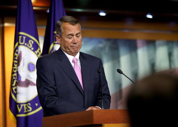House Speaker John A. Boehner (R-Ohio) listens to a reporter's question during a news conference Thursday on Capitol Hill.