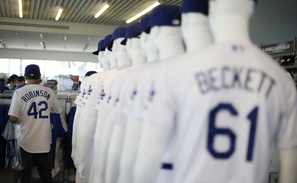 A Dodgers fan shops in a Dodger Stadium team store prior to the start of Game 4 of the National League Championship Series in October.