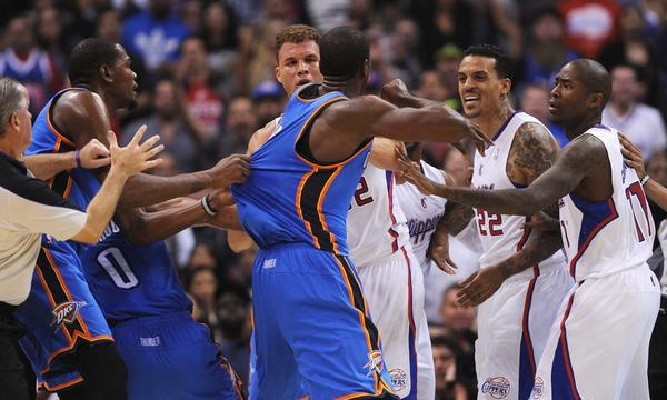 Oklahoma City's Serge Ibaka, left, is held back during a skirmish with Clippers teammates Blake Griffin, far left, Matt Barnes, second from right, and Jamal Crawford during Wednesday's game.