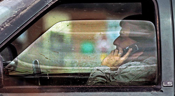 A driver talks on the phone in Montpelier, Vt.