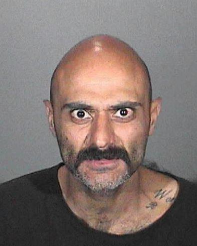 Arutyun Varvaryan, 30, was arrested on suspicion of attempted robbery and vandalism for reportedly trying to kick out window of a patrol car while he was driven to the Glendale jail on Thursday, Nov. 14, 2013, police said.