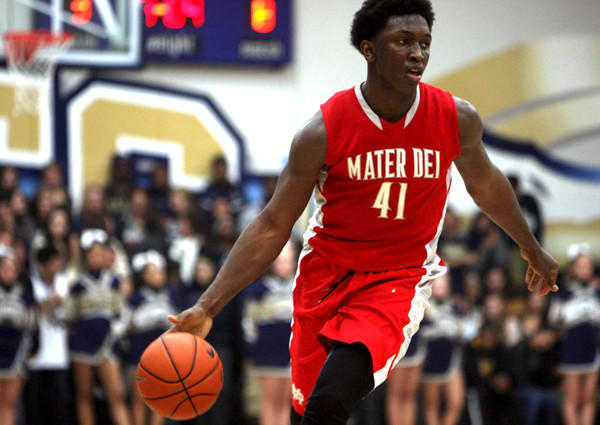 Mater Dei's Stanley Johnson brings the ball up the court during a game against St. John Bosco last season.