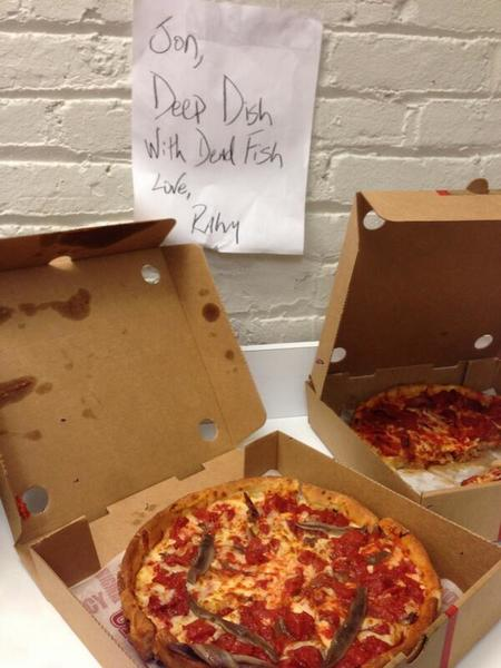 A photo tweeted by the Mayor's office late Thursday says Emanuel sent Jon Stewart's crew some pizza.