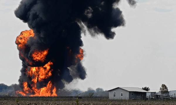 A fire burns in an open field outside Milford, Texas, after a gas pipeline exploded.