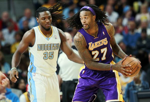 Lakers power forward Jordan Hill works in the post against Nuggets forward Kenneth Faried in the second half of the Lakers' loss Wednesday.