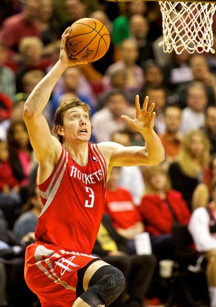 Rockets center Omer Asik dunks against Portland.