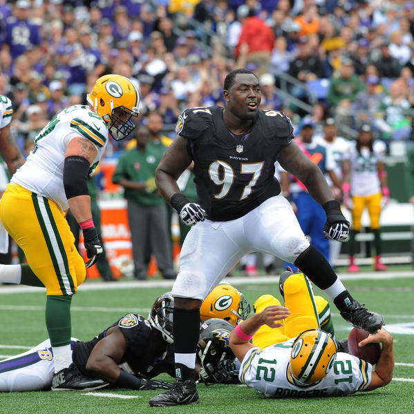 Ravens' Arthur Jones celebrates after sacking Green Bay Packers quarterback Aaron Rodgers in October.