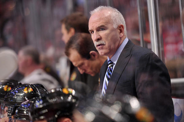 Blackhawks coach Joel Quenneville on the bench.