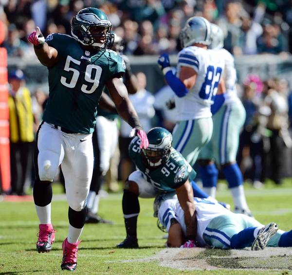 Eagles inside linebacker DeMeco Ryans (59), here celebrating a sack against Dallas quarterback Tony Romo on Oct. 20, is having a Pro Bowl-type season.