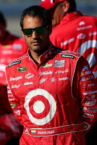 Juan Pablo Montoya, driver of the #42 Target Chevrolet, walks on the grid during qualifying for the NASCAR Sprint Cup Series AAA Texas 500 at Texas Motor Speedway on November 1, 2013 in Fort Worth, Texas.