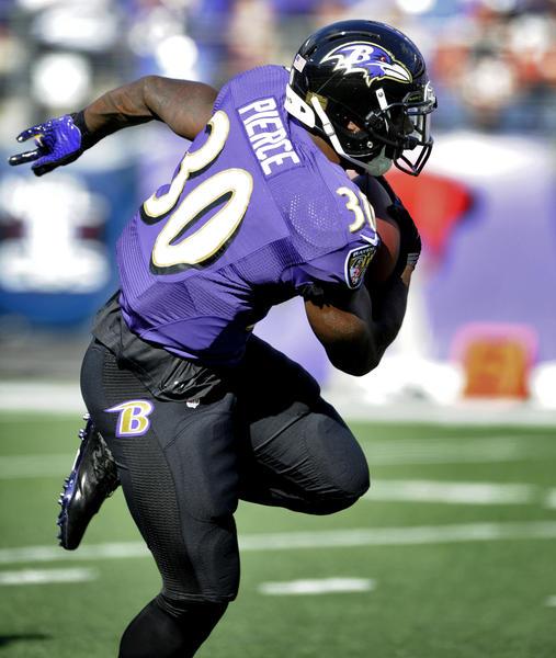 Ravens running back Bernard Pierce picks up a few yards against the Bengals last week.