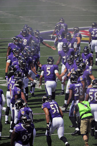 Ravens take the field before a game earlier this season.