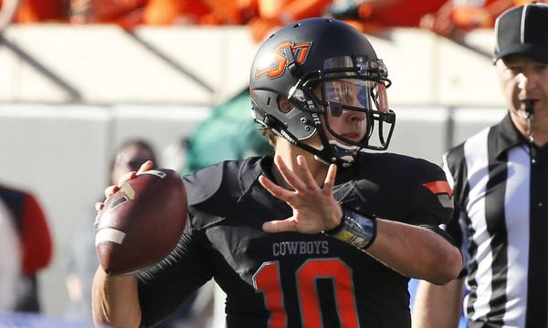 Quarterback Clint Chelf will look to lead Oklahoma State past a competitive Texas team on Saturday.