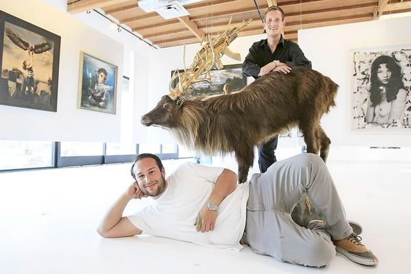 Owner Alexander Dax, bottom, and Director/curator Christopher Kane, top, pose for a portrait at Dax Gallery in Costa Mesa.