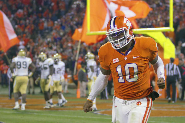 Clemson Tigers quarterback Tajh Boyd celebrates after scoring a touchdown during the third quarter against the Georgia Tech Yellow Jackets.