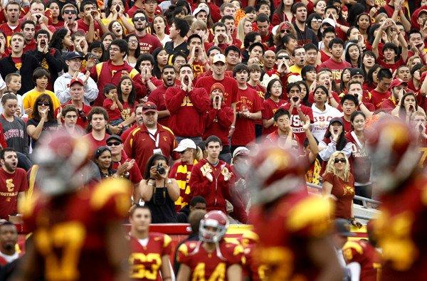 Fans cheer for USC during a game against California at the Coliseum in 2010, the only year in which the Trojans did not play in front of a capacity crowd.