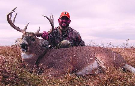 The author holds up a heavy South Dakota whitetail. Look for rutting activity to peak during the states rifle deer seasons  both West and East River  in 2013.