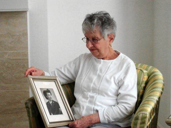 Grace Kagan of Allentown holds a photograph of herself when she was a Navy yeoman petty officer during World War II, one of many rich memories she can share.