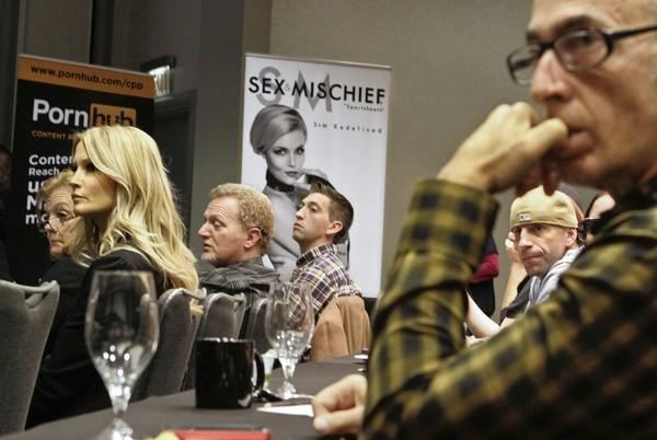 Adult-film performers Jessica Drake, left, and Barry Scott, lower right, are joined by others in the industry during an adult film industry summit at the Sofitel Hotel in Los Angeles for a panel discussion on the passage of Measure B, which required condom use in adult film production.