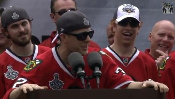 Kris Versteeg raps LMFAO at the 2010 Blackhawks championship rally in Chicago.
