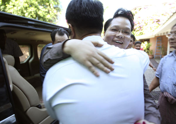 Aye Ne Win, right, a grandson of former dictator Gen. Ne Win, is welcomed by his younger brother Zwe Ne Win after his release Friday from Insein prison. He was one of 69 prisoners released during the day.