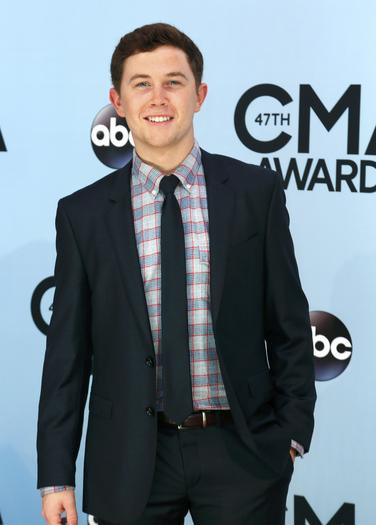 Scotty McCreery poses on arrival at the 47th Country Music Association Awards in Nashville.