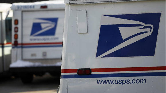 Mail trucks are parked at the Roberto Clemente Post Office at 2339 N. California Ave. in Chicago in February.