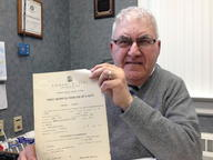 Joe Camposeo, the Manchester town clerk, holding the birth certificate of Giuseppe Camposeo, his Italian-born grandfather. These kinds of documents have become important to Camposeo over the last 15 years of running the towns genealogy road show.