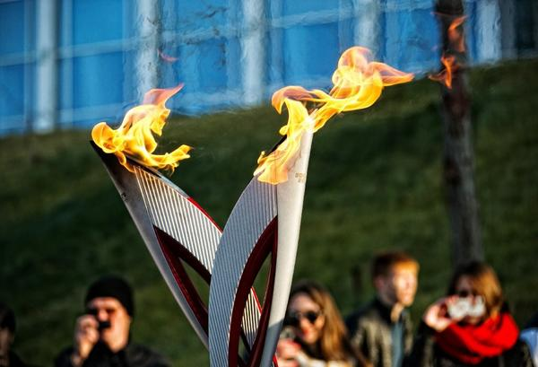 Torch bearers participate in the relay for the Sochi Winter Games.