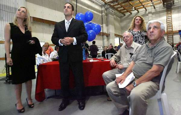 Campaign manager Stacey Brenner, candidate Mike Gatto and Ken Ahern and father Joseph Gatto listen to early returns on other races and propositions at an election party in Burbank on Tuesday, June 8, 2010. (Roger Wilson/NewsPress)