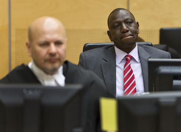 Kenyan Deputy President William Ruto, right, appears before the International Criminal Court in the Hague.