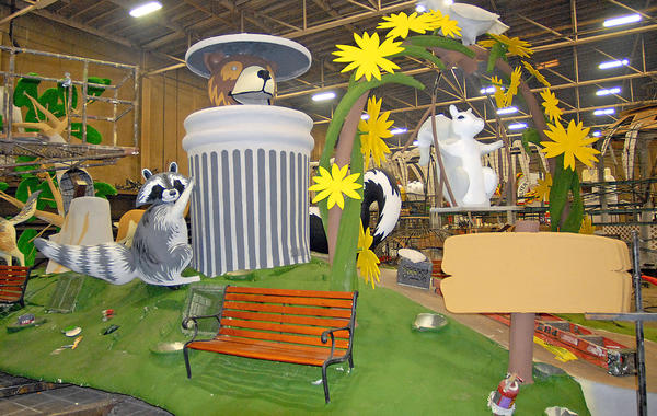 'Meatball' the Glendale bear peeks from a garbage can in a design created by Phoenix Decorating Company for Glendale's 2014 Tournament of Roses Parade float.