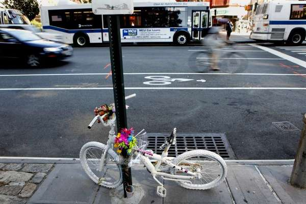 "A memorial at the spot where an 8-year-old boy was killed while riding his bike in New York. Similar ""ghost bikes,"" consisting of a bicycle painted white, often appear at the site of an accident as memorials to cyclists killed on the road."