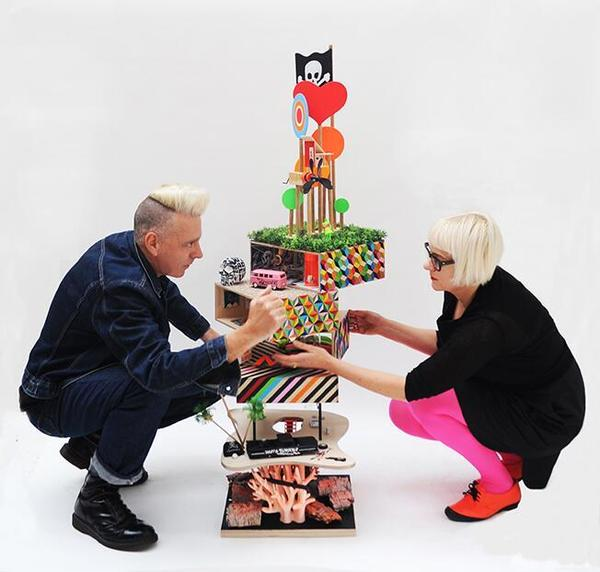 Architects Luke Morgan and Morag Myerscough install their dollhouse at Bonhams last week. Their design raised $7,400 for charity.