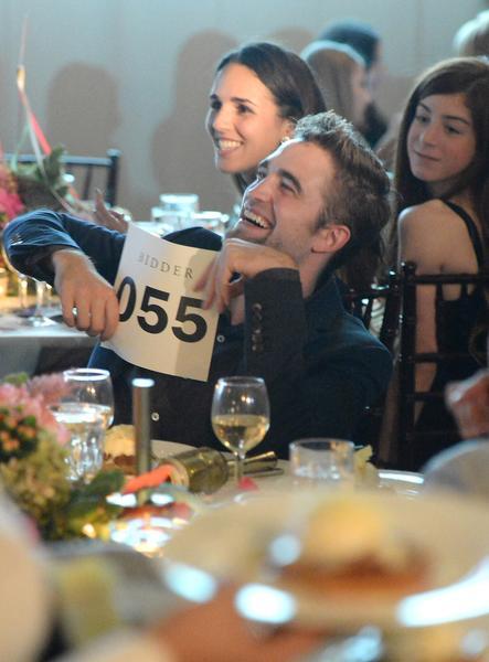 Robert Pattinson bids during the 6th Annual GO GO Gala at Bel-Air Bay Club on Thursday.