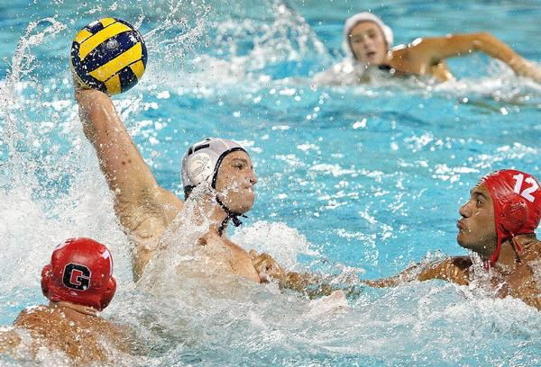 Crescenta Valley's Griffin Harting, center, and Glendale's Harut Bandikyan, right, are leading their respective teams into Saturday's Division V quarterfinals as Glendale hosts Webb at Burbank and Crescenta Valley travels to Pasadena Poly. (Roger Wilson/File Art)